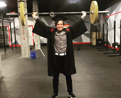 Emily Martin lifts barbell above her head